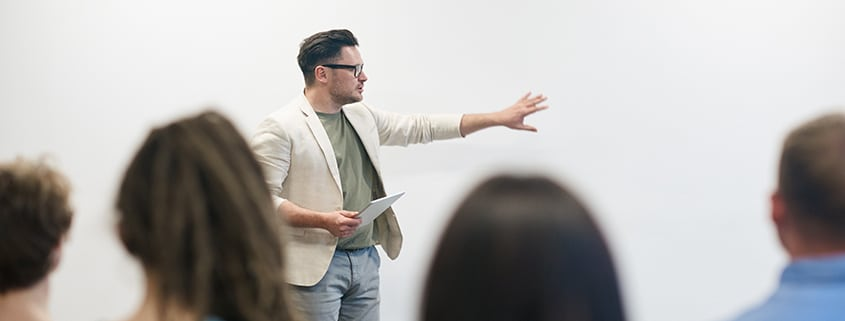 Man giving a business presentation to a group of people
